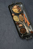 Spices for baking gingerbread or muffins: vanilla, cinnamon, buckwheat, coriander, cloves, cardamom, fennel, nutmeg. Stock Photos