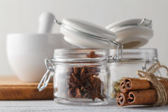 Spices on black background in special jars. Stock Image