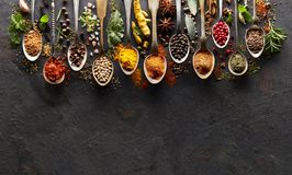 Spices on black board. In closeup stock image