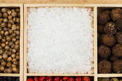 Spices and black rice in a wooden box Stock Images