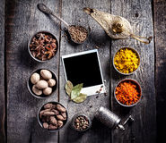Spices and blank photo at the table Royalty Free Stock Photos