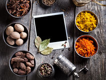 Spices and blank photo at the table Royalty Free Stock Photo
