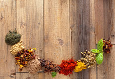 Spices border. Border frame on old wood made of colorful spices Royalty Free Stock Photos