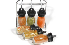 Spices in bottles. Close up, isolated on white Royalty Free Stock Image