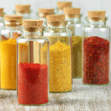 Spices in bottles Stock Photography