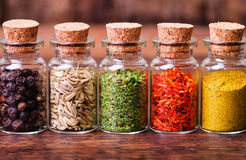Spices in bottles Royalty Free Stock Photo