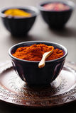 Spices in bowls: curry pink and black pepper paprika powder Royalty Free Stock Photos