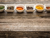 Spices in bowls in horizontal row Stock Photo