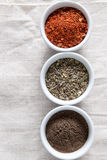 Spices in bowls on white tablecloth Stock Image