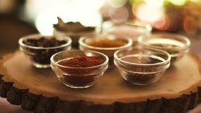 Spices bowls on wooden board. stock video