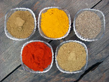 Spices and bowls on wooden. Indian spices and bowls on wooden stock photos