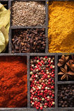 Spices in box. pink black pepper paprika powder curry bay leaf a Royalty Free Stock Photos