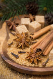 Spices and brown sugar for a Christmas baking in a wooden bowl Royalty Free Stock Photos