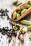Spices - cardamom and cloves. Stock Photo