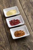 Spices in ceramic bowls Stock Photography