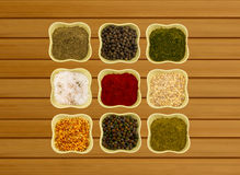 Spices in ceramic bowls on a wooden background fragrant paprika paprika fennel and coriander Stock Photography
