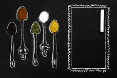 Spices on chalkboard Royalty Free Stock Images