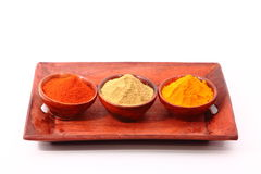Spices. Chilli, Turmeric and coriander on wooden bowl and tray Stock Photography