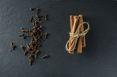 Spices cinnamon and cloves on the background of slate Stock Photo
