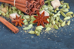 Spices. Cinnamon sticks, cardamom, star anise and brown sugar. The ingredients for Christmas baking Royalty Free Stock Images