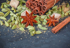 Spices. Cinnamon sticks, cardamom, star anise and brown sugar. The ingredients for Christmas baking Royalty Free Stock Photo
