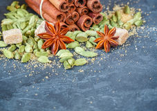 Spices. Cinnamon sticks, cardamom, star anise and brown sugar. The ingredients for Christmas baking Stock Image