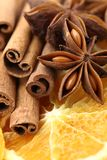 Spices. Close-up of dry orange slices, cinnamon sticks, and anise stars stock image