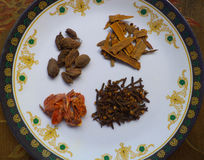Spices. Cloves, cardamom, cinnamon and mace Royalty Free Stock Image
