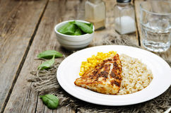 Spices Cod with brown rice, spinach and corn Stock Images
