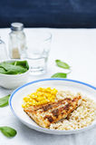 Spices Cod with brown rice, spinach and corn Stock Photography