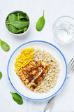 Spices Cod with brown rice, spinach and corn Royalty Free Stock Images