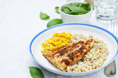 Spices Cod with brown rice, spinach and corn Stock Photos