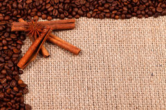 Spices with coffee beans on burlap Royalty Free Stock Image