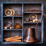 Spices, coffee and chocolate in a wooden old tray Royalty Free Stock Photo