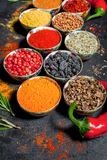 Spices. Colorful spices. Curry, Saffron, turmeric, cinnamon and otheron a dark concrete background. Pepper. Large collection of di Stock Images
