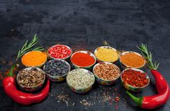 Spices. Colorful spices. Curry, Saffron, turmeric, cinnamon and otheron a dark concrete background. Pepper. Large collection of di Stock Photos