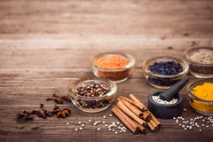Spices and condiment for cooking. Turmeric, pepper, barberry, cinnamon, carnation on the table. Copy space at the top Stock Photography