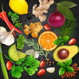 Spices, condiments and herbs with fruits on the blackboard chalk background Stock Images