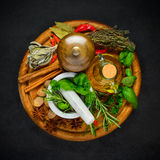 Spices and Condiments. Top View of Different Types of Condiments, Spices and Seasoning on Dark Background Royalty Free Stock Photos