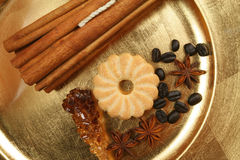 Spices and cookies. Cookies, spices and coffee beans on golden plate. Christmas composition Royalty Free Stock Photo