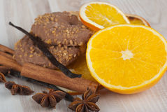 Spices and cookies. Cinnamon sticks, anise stars, vanilla and dried orange slices Royalty Free Stock Images