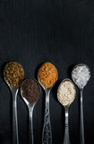 Spices for cooking meat. Dishes sprinkled in a spoon stock images