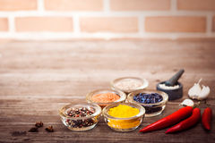 Spices for cooking meat: turmeric, chili pepper, barberry Royalty Free Stock Images