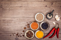 Spices for cooking meat: turmeric, chili pepper, barberry. On the wooden table. Top view. Copy space left. Horizontal Royalty Free Stock Image