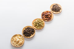 Spices for cooking. Various spices to cook a variety of flavors, chilli, garlic, black pepper, cloves, cardamom Stock Image