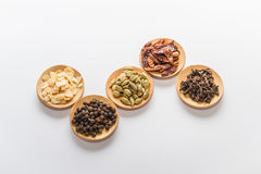 Spices for cooking. Various spices to cook a variety of flavors, chilli, garlic, black pepper, cloves, cardamom Stock Photos