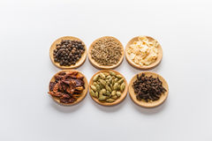 Spices for cooking. Various spices to cook a variety of flavors, garlic, cardamom, anise, cloves, black pepper, chilli Royalty Free Stock Images