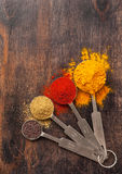 Spices coriander, paprika, curry, mustard seeds. Spice over Wood. Colorful spices in measuring spoons Stock Photography