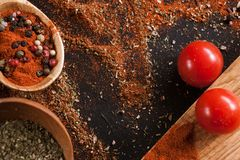 Spices. Culinary, cuisine, recipe background. Variety of pepper on black table, free space and closeup. Menu, blog concept Royalty Free Stock Images
