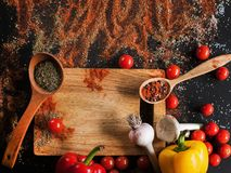 Spices. Culinary, cuisine, recipe background. Variety of vegetables on black table, free space and closeup. Menu, blog concept Royalty Free Stock Images
